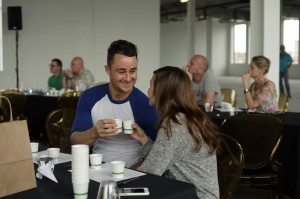 Couple toasting in cupping seminar